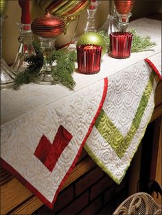 """The basic style of this pieced mantel scarf is perfect for showcasing your most lavish quilting designs and other personal touches such as your favorite beads, buttons, embroidery or even a festive holiday applique. This e-pattern was originally published in the December 2010 issue of Quilter's World magazine.   Size: 48"""" x 24"""" / Skill Level: Easy / Designed by Carolyn S. Vagts"""