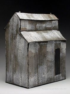 Mary Fischer: Inspiration for a farm shed using corrugated cardboard  http://www.cardboardhouse.co.uk