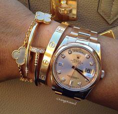 Rolex Cartier and VCA bracelets