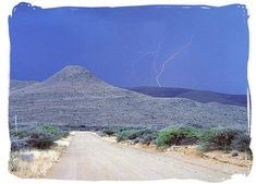 Gravel road and thunderstorm in the Karoo - South Africa