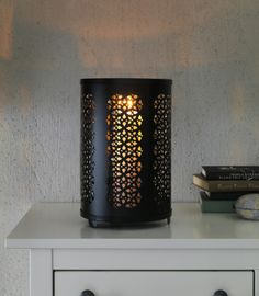Enjoy the warmth of candlelight from this decorative lantern