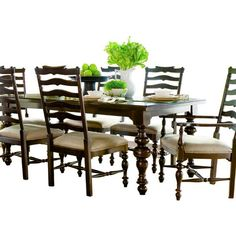 This stained wood, lightly distressed table comfortably seats up to 10 with both leaves inserted. The rich brown finish and intricately carved legs give it warmth.