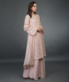 From our Wedding Festive Collection, this is a nude pink pure georgette sharara suit with intricate exquisite rose gold gota patti hand embroidery. The shirt has rose gold gota patti hand embroidery all over in lattice pattern. Pakistani Outfits, Indian Outfits, Indian Clothes, Gota Patti Suits, Pakistan Street Style, Desi Wear, Pakistan Fashion, Indian Designer Wear, Indian Dresses