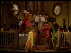 Kermit and Fozzie come to rest outside a church, hear music coming from inside and discover 'The Electric Mayhem' who disguise their car for them.