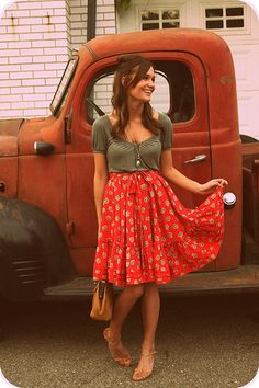 Red skirt with a unique pattern paired with a plain grey top