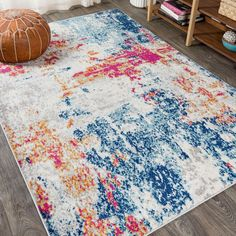Inspired by the colors of an ocean sunset, this bold rug is modern art for your floor. Blues, reds and accents of gold splash and mingle in a random abstract design. This unique rug's overall pattern makes it perfect for homes with kids and pets. It's the perfect centerpiece for a mid-century modern, contemporary, or beach house. #JonathanY #HomeDeco #AreaRugs #InteriorDesign Ocean Sunset, Unique Rugs, Rug Cleaning, Home Rugs, Home Decor Trends, Animals For Kids, Coastal Decor, Pattern Making, Lighting Ideas