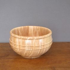 Small wood salad bowl is made from curly maple wood and makes a great serving bowl for two. Bowl can serve approximately two salads, depending