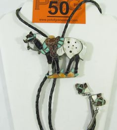 "Lot 50 in the special Saturday 9.21.13 online & live auction! Fabulous large sterling silver bolo tie with Southwestern style design. Figural bolo is shaped like a horse with Tortoise shell, turquoise, mother of pearl, coral and jet or onyx in mosaic design. Bolo hangs on braided leather ties accented with horse head charms. Signed ""Joe Zuni"". #Jewelry #Fashion #POGAuctions"