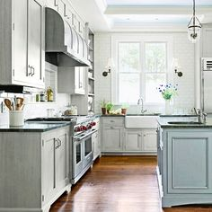 Blue island, blue ceiling - brushed nickel faucet and oil rubbed bronze hardware mixed... Love this kitchen