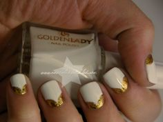 A new take on the half moon mani. LOVE the gold and white combo! via Emerald Sparkled