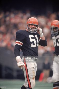 Linebacker Ken Avery of the Cincinnati Bengals adjusts his helmet between plays against the Cleveland Browns during a game at Riverfront Stadium on December 1973 in Cincinnati, Ohio. The Bengals defeated the Browns Nfl Oakland Raiders, Cincinnati Bengals, Nfl Football Players, Football Helmets, Nfl Saints, Nfl Uniforms, American Football League, Browns Football, Association Football