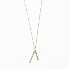 our signature dart pendant made of bronze hung on a delicate 18 inch gold fill chain. perfect for simple everyday adornment. Arrow Necklace, Gold Necklace, Feather Jewelry, Affordable Jewelry, Jewelry Accessories, Bangles, Bronze, Bling, Jewels