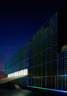 Ystad Arena, Sweden. Between the structure and the façade; mounted in the space between concrete and aluminium, a giant panel of computer-controlled LED lighting brings a dynamic component to the building's expression. The space between the structure and the facade also allows for deeply recessed windows—an elegant and aesthetically appealing solution that also fills the building with reflected daylight. Photo by Åke Eson Lindman