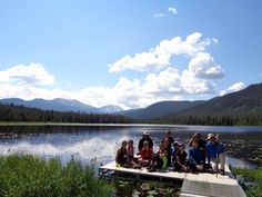 """I wen on a trip up 3 14ers (if you don't know what that means, then it means 14,000 feet in altitude, like pikes peak aka a mountain) and my trip group was called TASC or teen adventure survice camp, and this was a picture of us at """"Strawberry Lake"""" on the mountain. It was absolutely amazing!"""