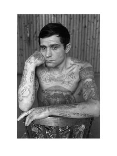 This convicts apparently random tattoos denote his rank within the criminal world. They embody a thief's complete 'service record', his entire biography, detailing all of his achievements and failures, his promotions and demotions, his 'secondments' to jail and his 'transfers' to different types of 'work'. A thief's tattoos are his 'passport', 'case file', 'awards record', 'diplomas' and 'epitaphs'. In this world a man with no tattoos has no social status whatsoever.
