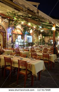 Outdoor cafe at night in Rhodes, Greece - stock photo
