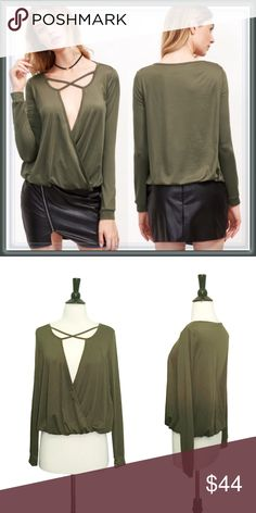 NWT plunge spliced blouse top ➖NWT ➖SIZE: Small, Medium, Large ➖STYLE: A spliced green top with a deep plunge neckline. The shirt cinches at the bottom. Great for a night out! Tops Blouses