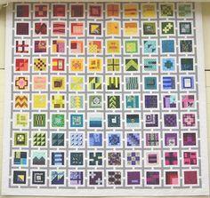 Tula Pink's City Sampler 100 Modern Quilt Blocks. Love the setting.