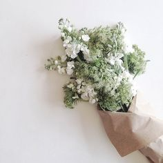 floral bouquets in brown paper //