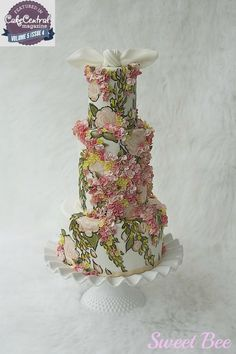 I made this cake for the latest issue of Cake Central Magazine. The inspiration photo was beautiful (last photo). I knew that if someone else was designing on this, they would probably go for doing hand crafted flowers, which are not my strength....