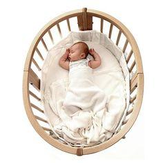 The Stokke Sleepi bed's distinctive narrow oval shape creates a nest-like environment.