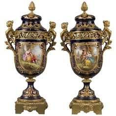 For Sale on - A pair of century French Sevres gilt bronze mounted cobalt blue lidded urns. France, circa Having figurative gilt bronze mounts depicting female