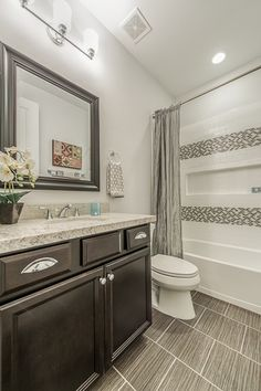 Traditional Full Bathroom with High ceiling, Raised panel, specialty door, Complex Granite, specialty tile floors