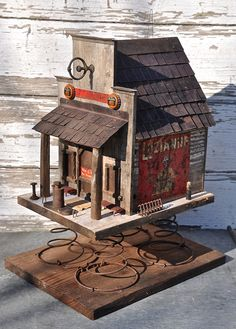 Country store birdhouse on springs by CrescentPond on Etsy, $365.00