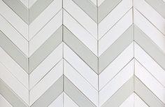 Chevron tiles in a herringbone pattern