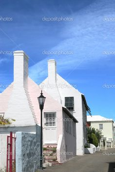 Bermuda - cottages on a side street in the community of St George's.  Bermuda, officially the Bermudas or Somers Islands, is a British overseas territory in the North Atlantic Ocean. Located off the east coast of the United States, its nearest landmass is Cape Hatteras, North Carolina