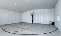 Indoor Basketball Court In Metal Building At The Most Basic Level But Perfect