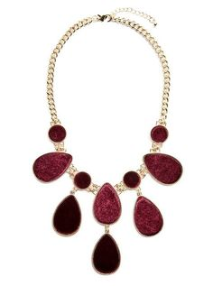 Velvet tear drop shapes fall from this glistening gold-tone necklace, making it a polished addition to any ensemble   MARCIANO.com
