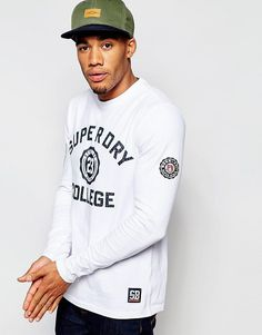 Discover men's t-shirts and vests at ASOS. Shop from plain, printed and long sleeve t-shirts and vests to longline and oversized styles with ASOS. T Shirt Vest, Superdry, Hoodies, Sweatshirts, Fashion Online, Long Sleeve Tops, Asos, Graphic Sweatshirt, Mens Tops