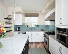 I like the backsplash with the mix of dark and white cabinets.