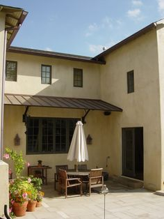 Metal roof for back patio french doors