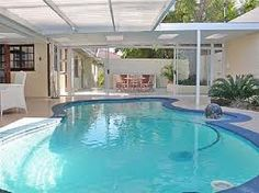 Indoor pool with a retractable roof!  Awesome!! Swim year round!