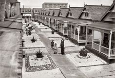 """Vacation bungalow colony at Rockaway, Queens, c. 1910. George Grantham Bain Collection. Note """"front yards"""" of sand decorated with seashells."""