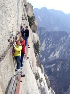 Don't look down: Hikers navigate the walkway on Huashan mountain (Picture: Rex)