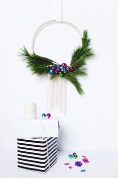 If you need a quick and easy holiday project, this DIY Scandinavian Style Wreath is THE ONE! This wreath has fresh greenery and bright colors for a new spin on the old classic