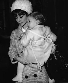 The actress Audrey Hepburn photographed with her son Sean, at the exit of Hotel Hassler at Trinita dei Monti in Rome (Italy), November 1961.