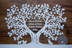 """A beautifully crafted Family Oak tree  paper cut.  This Item fits up to 7 names and any animals items you wish at the bottom.  Designed and hand cut by myself using one piece of soft white acid free paper.Item is unframed and comes a sheet of backing paper available in many colours (photo three).<b>***Please leave the Information you require on the cut in the """"Note to Seller"""" section when making the payment through Paypal. ***Things I need to know:- Nam..."""