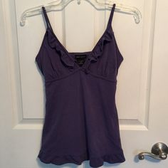 """MODA INTERNATIONAL Purple Bra Top CAMI Size Small Up for your consideration is this Adorable MODA INTERNATIONAL Purple Bra Top CAMI With Ruffle Trim & Adjustable Strap With Tie Back. Size Small. Measurement Across Bust is 15"""" laid flat for total of 30"""". Material is 95% Cotton 5% Spandex. Dress up or down!! Thanks for looking! Have a blessed day ❤️ PayPal TRADES  Comes from a smoke free home  Bundle for additional savings!  I ship out same day!  God bless  Moda International Tops Camisoles"""
