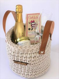 Celebrate in style with a bit of bubbles and fizz! With a Bottega Gold Prosecco and champagne glass. A gold tin soy candle from Amanda Jayne, and a bar of luxurious crunchy nougat chocolate from Ooh La La! The gift is packaged in a taupe eco-friendly proudly South African crochet basket with leather straps. The perfect Keepsake! Or in one of our classical gift boxes, tied with a pale pink satin ribbon. The perfect Wedding Gift for the Bride!
