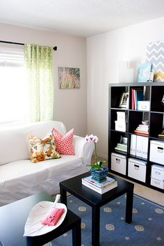a look i can replicate.  i love the idea of having two little coffee tables instead of one.