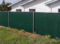 Chain Link Fence Privacy Ideas diy ~ beautify a chain link fence with bamboo! | chain link