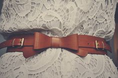 love the leather bow belt atop lace dress. best paired with matching hued leather flats and simple accessories.