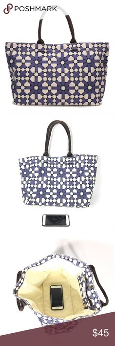 Lulu Dharma's Flower Geometric Tote Bluish PURPLE FLOWER GEOMETRIC TOTE BAG  Add a splash of glamour and color to your life adventure with this Lulu Dharma Tote. The perfect everyday for everything, life bag (work, play, family, picnic, shopping etc. Chic enough to wear at any restaurant or glamorous event. Eco-friendly and vegan, with round magnetic closure, inside zip pocket, side pocket and woven handles. Water- resistant lining and generously thick exterior canvas. Measures 17 x 12.5 x…