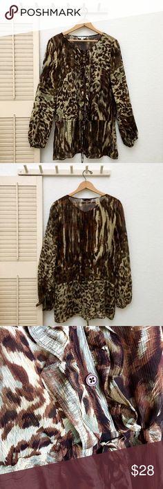 CAbi Silk Crêpe Animal Print Tunic, w/Drop Peplum More details to come... CAbi Tops Blouses