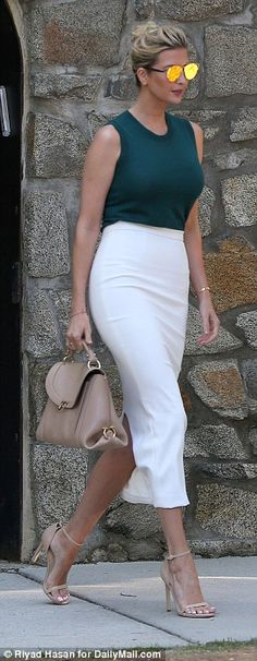 Ivanka, 35, was photographed leaving her Washington, D.C. home on Tuesday morning wearing a sleeveless hunter green top tucked into a white pencil skirt.