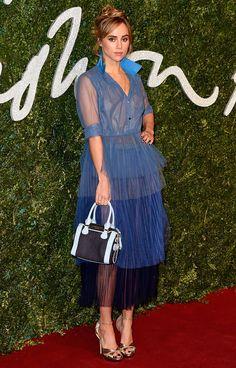 Suki Waterhouse in top-knot bun hairstyle wearing Burberry Prorsum SS 2015blue to navyombrepleated ruffles sheerskirt ensembleBest DressedatThe British Fashion Awards 2014 BFAs.